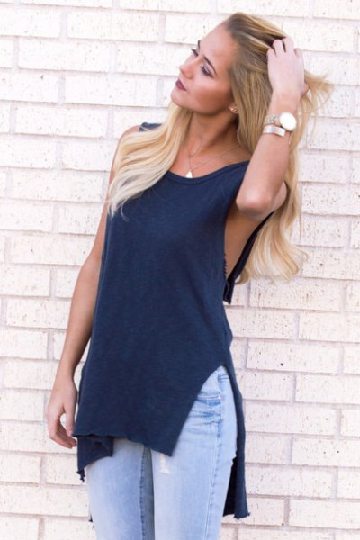 navy blue sleeveless cutout top with light blue jeans