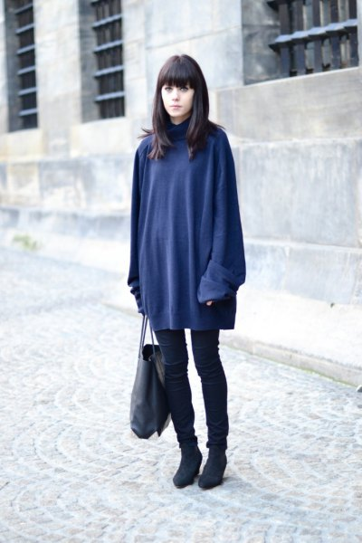 navy blue sweater dress over black skinny jeans