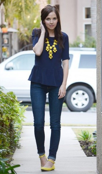 navy peplum top with yellow statement necklace