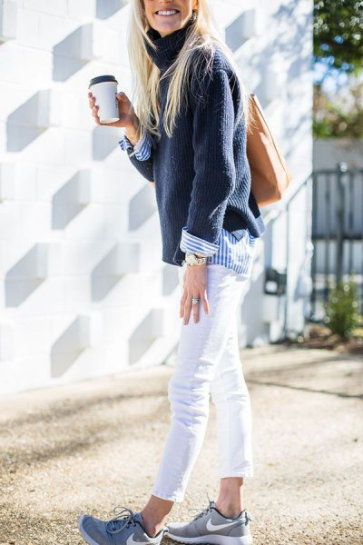 navy sweater with blue and white striped button up shirt