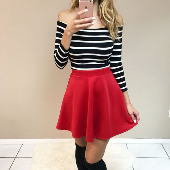 off the shoulder black and white striped long sleeve top with red skater skirt