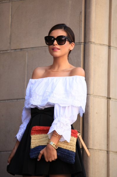 off the shoulder blouse with navy high waisted flared mini skirt