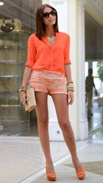 orange and white printed mini shorts and gold statement necklace