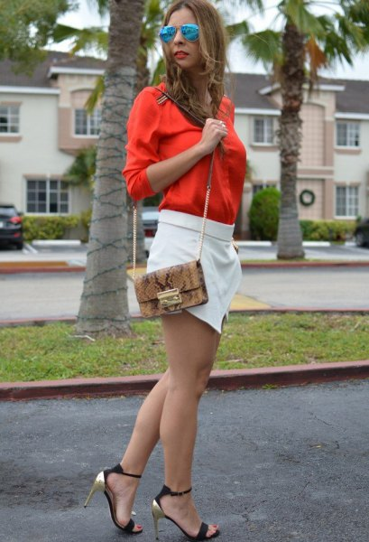 orange button up shirt with white skort