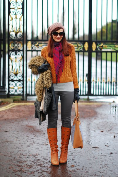 orange cable knit sweater with matching knee high boots