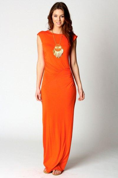 orange cap sleeve dress with boho style statement necklace