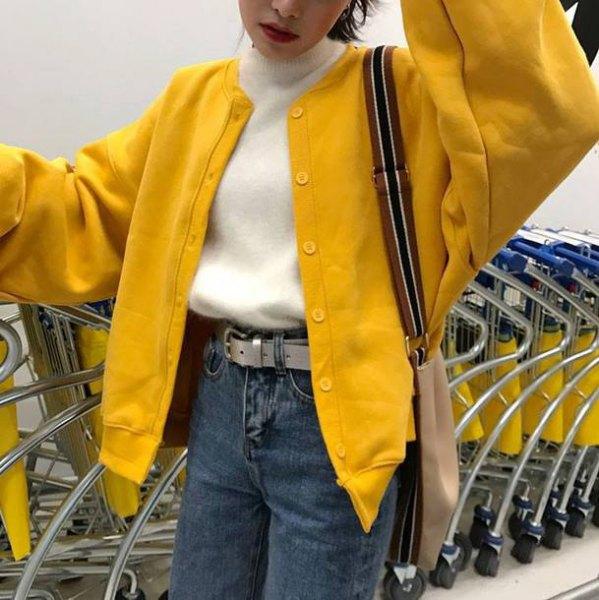 oversized lemon yellow bomber jacket with white mock neck sweater