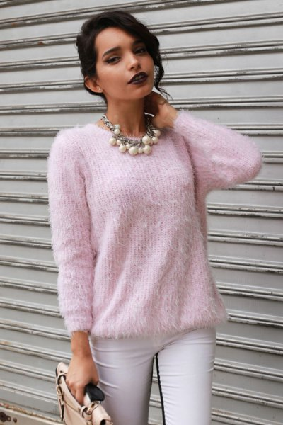 pale pink fuzzy sweater with white skinny jeans
