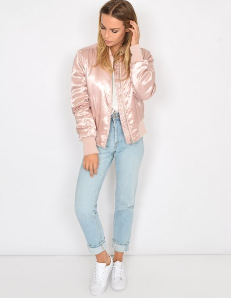 pale pink satin bomber jacket with white shirt and light blue jeans