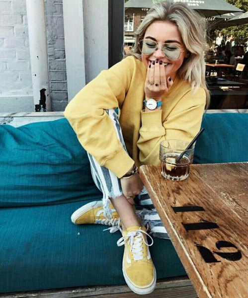 pale yellow sweatshirt with matching canvas sneakers
