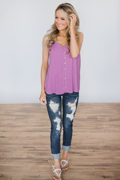 purple button up vest top with ripped skinny jeans