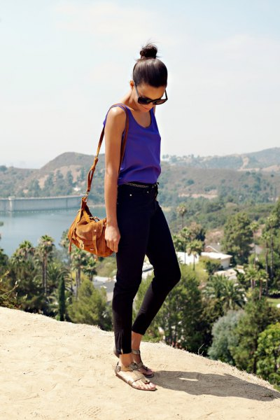 purple crew neck vest top with black ankle jeans