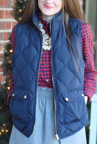 purple quilted vest with blue and pink checkered shirt