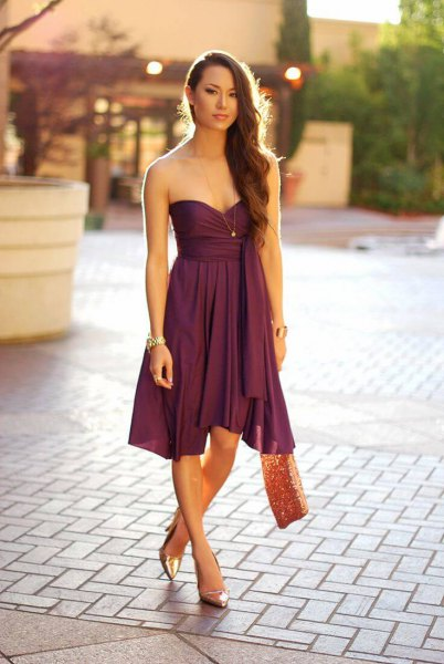 purple sweetheart neckline flared midi dress with bronze heels