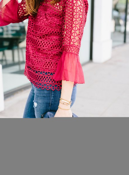 red bell sleeve crochet lace blouse with skinny jeans