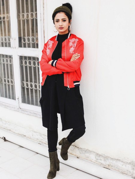 red embroidered bomber jacket with black crew neck sweater and skinny jeans