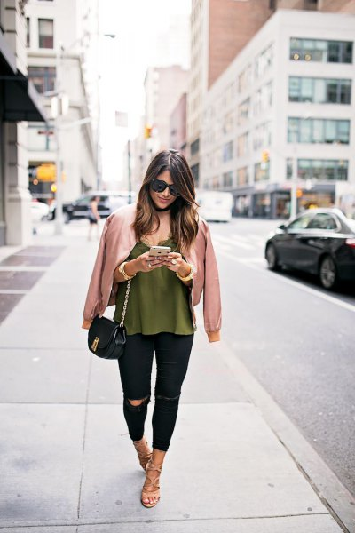 rose gold jacket with green vest top and black jeans