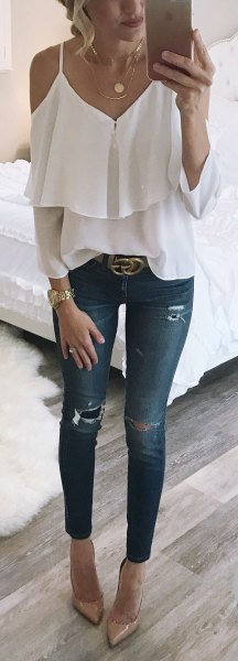 ruffle top with skinny ankle jeans and statement belt