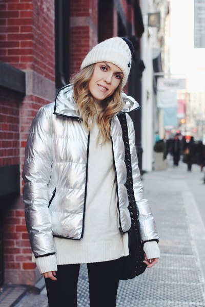 silver down jacket with white knit sweater