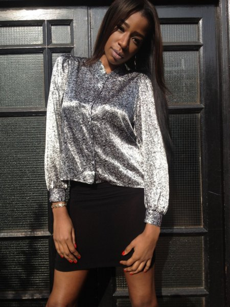 silver metallic button up blouse with black mini skirt