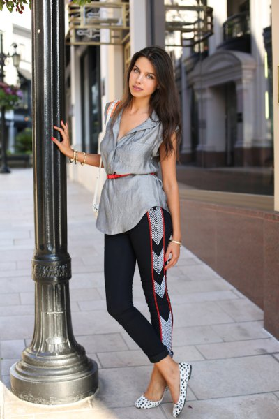 silver sleeveless belted blouse with black cropped pants