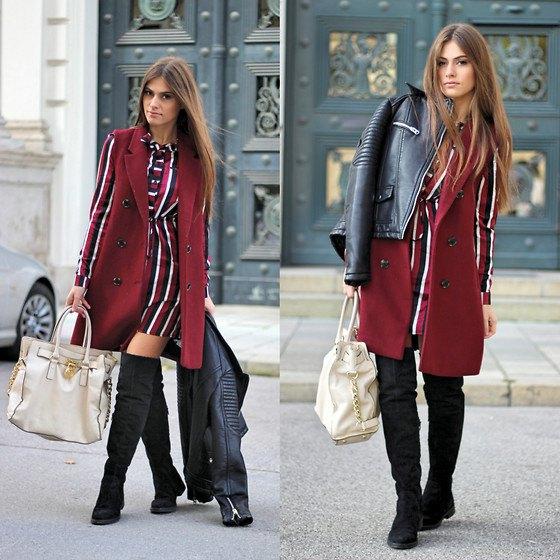 sleeveless burgundy coat over red white and black striped long sleeve dress