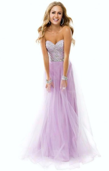 sweetheart fit and flare floor length tulle dress with silver sequin cuff bracelet