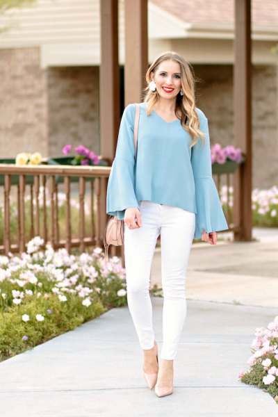 teal blue bell sleeve blouse with white skinny jeans