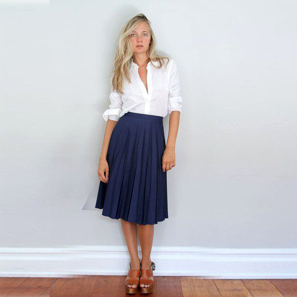 white button up shirt with navy midi pleated skirt
