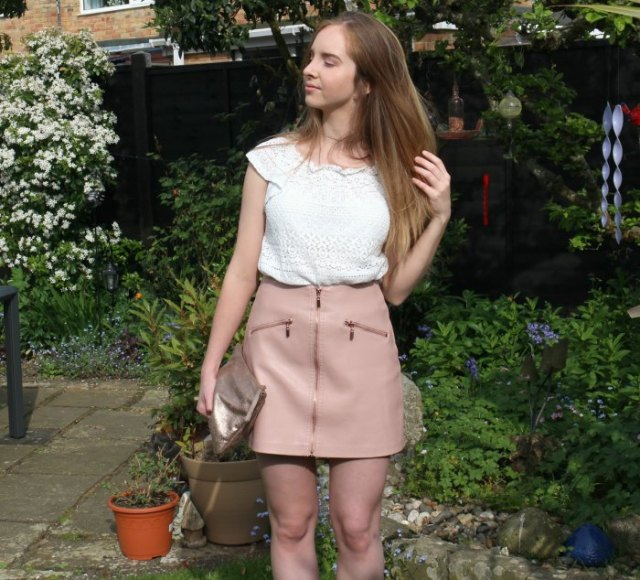white cap sleeve crochet lace top with pink zip front leather mini skirt