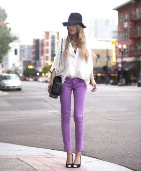 white chiffon wide sleeve blouse with purple skinny jeans and floppy hat