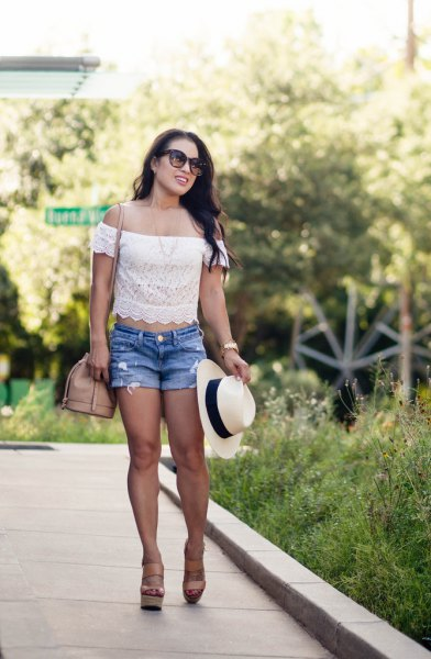 white cropped off the shoulder lace top with blue denim shorts