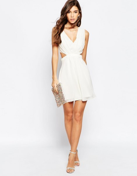 white deep v neck cut out side mini flared dress with sequin clutch bag