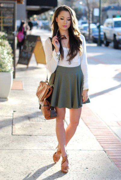 white form fitting long sleeve tee with grey high waisted mini skater skirt