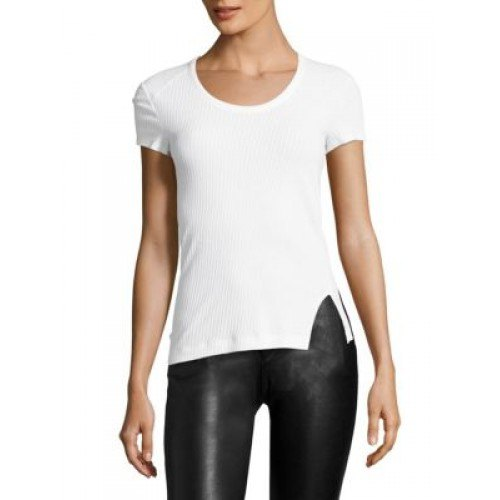 white form fitting tee with black leather leggings