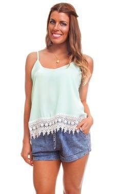 white lace hem top with blue mini denim shorts