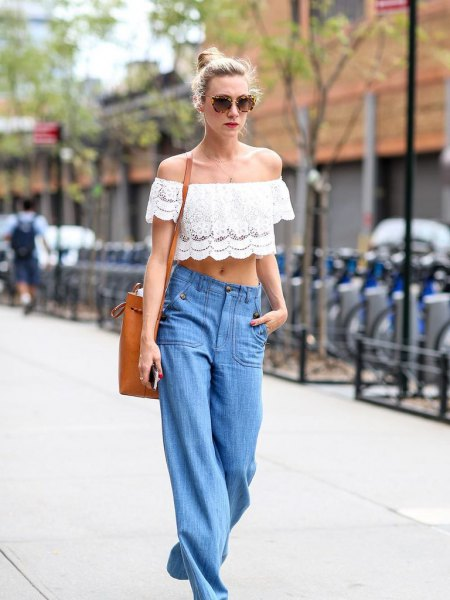 white lace off the shoulder crop top with wide leg blue jeans
