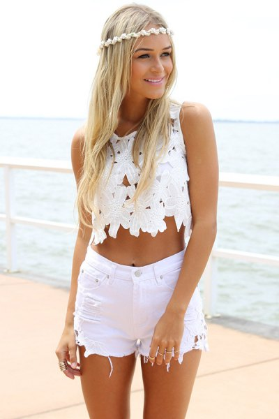 white lace sleeveless crop top with high waisted ripped shorts