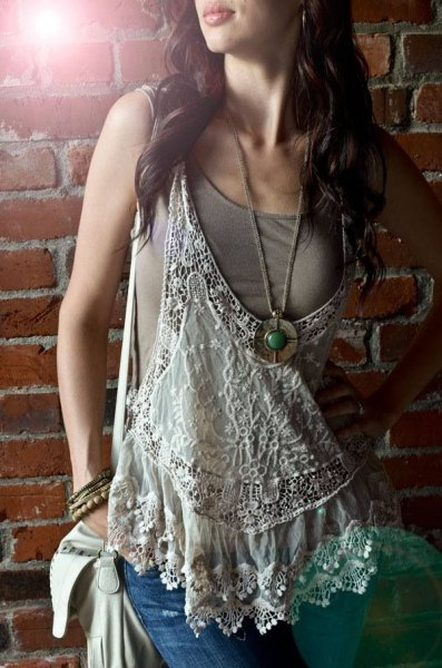 white loose fit low cut lace tank over green top