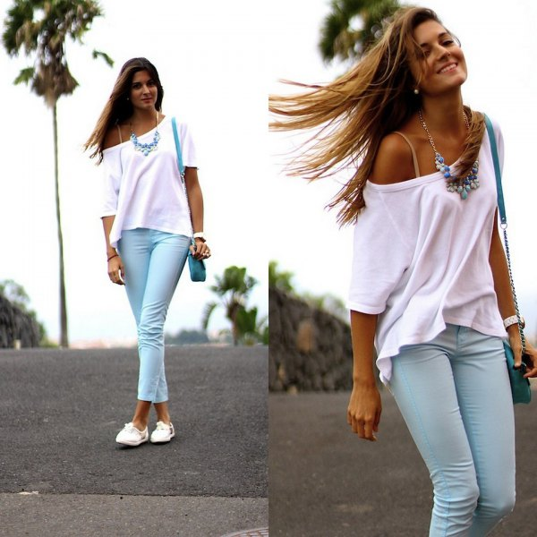 white one shoulder short sleeve sweater with light blue cuffed pants