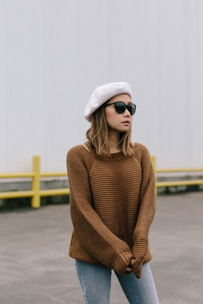 white painter hat with knit sweater and grey jeans