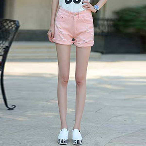 white print tee with pale pink cuffed shorts and sneakers