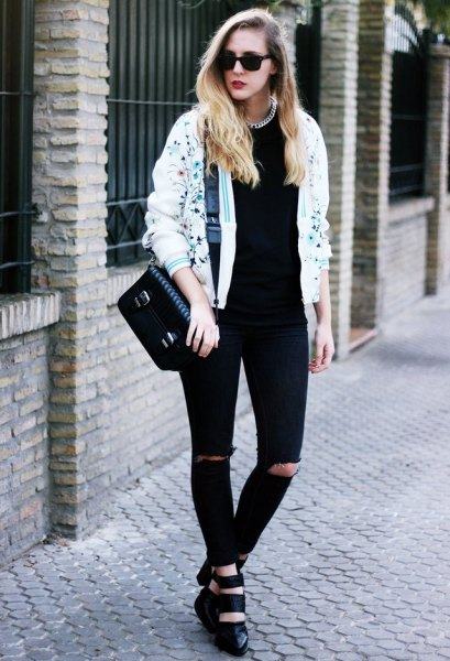white printed bomber jacket and black ripped jeans