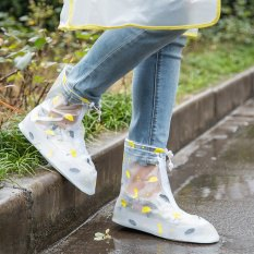 white semi sheer rubber snow and rain boots with jeans and tee