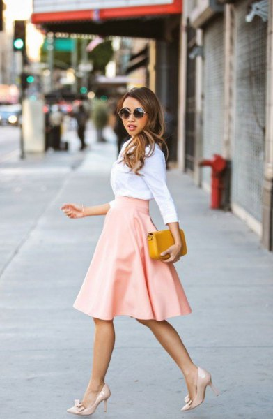 white shirt with high waisted flared midi leather pink skirt