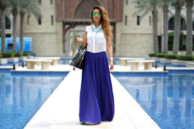 white sleeveless button up shirt with blue chiffon pleated maxi skirt