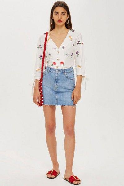 white v neck printed blouse with blue denim mini skirt