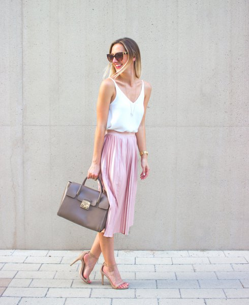 white v neck vest top with pink midi pleated skirt