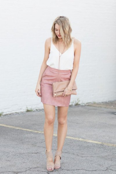 white v neck vest top with pink mini bodycon skirt