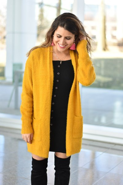 yellow long cardigan with black mini shift dress